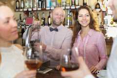 Couple drinking wine at bar Royalty Free Stock Photos
