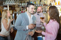 Couple drinking wine at bar Stock Images