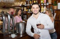 Couple drinking wine at bar Royalty Free Stock Photos