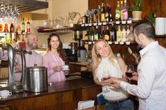 Couple drinking wine at bar Royalty Free Stock Photo