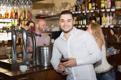 Couple drinking wine at bar Stock Photography