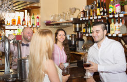 Couple drinking wine at bar Stock Image