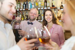Couple drinking wine at bar Royalty Free Stock Images