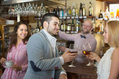 Couple drinking wine at bar Royalty Free Stock Photography