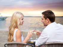 Couple drinking wine in cafe on beach Royalty Free Stock Photo
