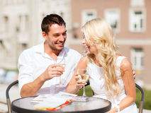 Couple drinking wine in cafe Stock Photos