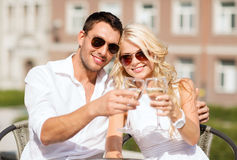 Couple drinking wine in cafe Royalty Free Stock Photography