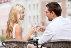 Couple drinking wine in cafe Stock Photography
