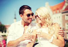 Couple drinking wine in cafe Stock Images