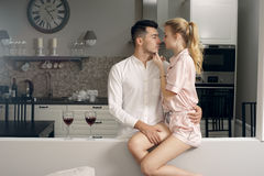 Couple drinking wine at home Stock Photos