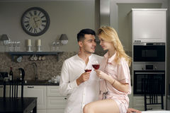 Couple drinking wine at home Royalty Free Stock Image