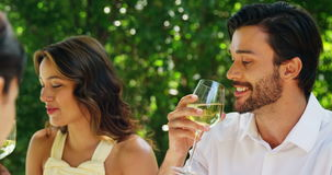 Couple drinking wine at outdoor restaurant. Happy couple drinking wine at outdoor restaurant stock video