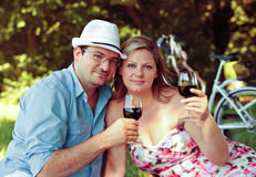 Couple drinking wine in the park Royalty Free Stock Images