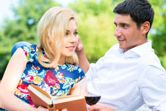 Couple drinking wine reading book Stock Photo