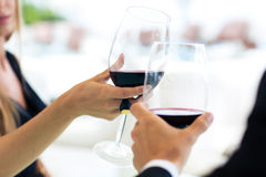 Couple drinking wine in restaurant Royalty Free Stock Images
