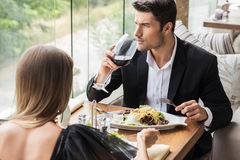 Couple drinking wine in restaurant Royalty Free Stock Photo