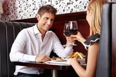 Couple drinking wine at restaurant Stock Photos