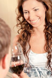 Couple drinking wine and smiling Royalty Free Stock Photos