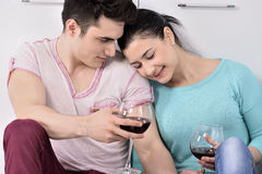 Couple drinking wine in their kitchen Royalty Free Stock Photos