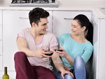 Couple drinking wine in their kitchen Stock Photography