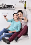 Couple drinking wine in their kitchen Royalty Free Stock Image