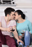Couple drinking wine in their kitchen Royalty Free Stock Photo