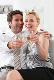 Couple with drinks Royalty Free Stock Image