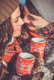 Couple drinks hot tea in winter park Royalty Free Stock Photo