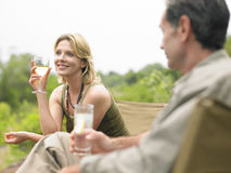 Couple With Drinks Outdoors Royalty Free Stock Photography