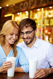 Couple with drinks Stock Photography