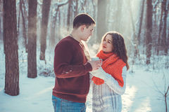 Couple drinks tea in winter forest Royalty Free Stock Photo
