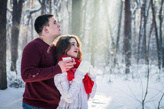Couple drinks tea in winter forest Royalty Free Stock Photography