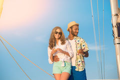 Couple with drinks on yacht. Royalty Free Stock Image