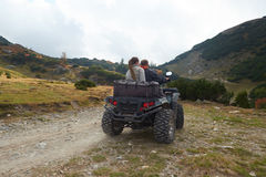 Couple drive atv quad bike Stock Photo