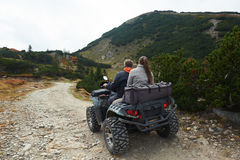 Couple drive atv quad bike Stock Images