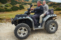 Couple drive atv quad bike Royalty Free Stock Images