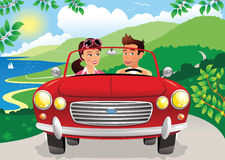Couple driving along coastal road. A young couple driving in a classic sports car along a twisting coastal road. E.P.S. 10 vector file included with image Stock Images