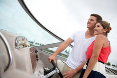 Couple driving a boat Royalty Free Stock Photos