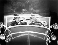 Couple driving a car. (All persons depicted are no longer living and no estate exists. Supplier grants that there will be no model release issues Royalty Free Stock Images