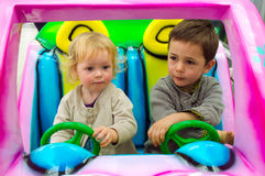 Kids driving a toy car Stock Photography