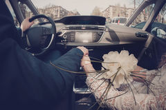 Couple is driving in the car Stock Image