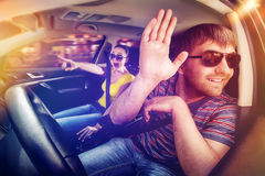 Couple driving in the car Royalty Free Stock Photos