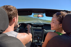 Couple driving car on road trip travel vacation Royalty Free Stock Photos