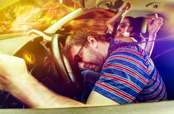 Couple driving in the car Stock Photos