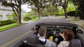Couple driving convertible car stock footage