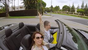 Couple driving convertible car stock video footage