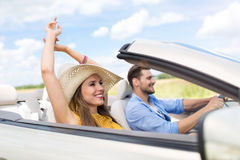 Couple Driving in Convertible Stock Photography