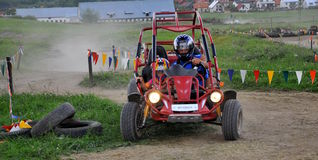 Couple driving Dune Buggy Stock Photos