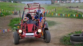 Couple driving Dune Buggy Stock Photo