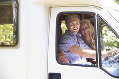 Couple Driving Motor Home On Vacation Stock Photo